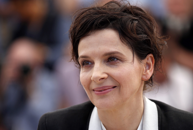 "Cast member Juliette Binoche poses during a photocall for the film ""Sils Maria"" in competition at the 67th Cannes Film Festival in Cannes"
