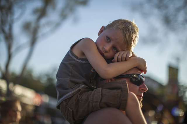 A boy is carried at the Los Angeles County Fair in Pomona