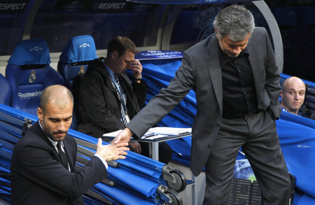 Real Madrid's coach Jose Mourinho (R) shakes hands with Barcelona's coach Pep Guardiola before their Champions League semi-final first leg soccer match at Santiago Bernabeu stadium in Madrid April 27, 2011. REUTERS/Sergio Perez (SPAIN - Tags: SPORT SOCCER) - RTR2LOFS