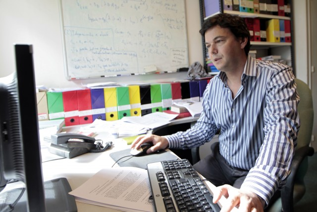 French economist Thomas Piketty works in his office in Paris