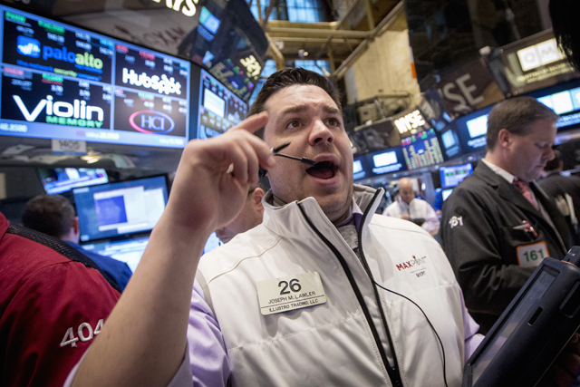 Trader Joseph Lawler works on the floor of the New York Stock Exchange