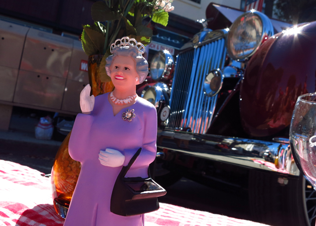 A figurine of a waving Queen Elizabeth, is displayed in front of a 1937 MG VA Tourer during the Little Car Show in Pacific Grove, California, August 13, 2014. The event, which showcases small cars with up to 1,601cc engines as well as electric cars, is held during the Pebble Beach Automotive Week which culminates with the Concours d'Elegance. REUTERS/Michael Fiala (UNITED STATES - Tags: SOCIETY TRANSPORT) - RTR42CGJ