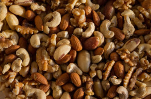A top down shot of a selection of mixed nuts. Use this for articles on health and health, especially natural living, healthy eating, organic lifestyle, omega 3 fats.