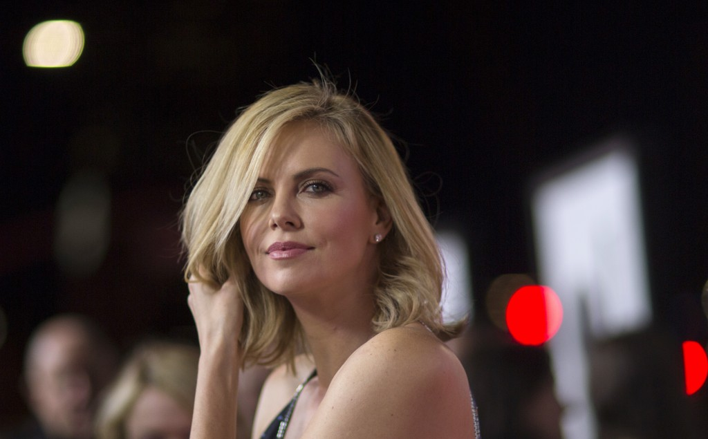"Theron attends the premiere of ""The Gunman"" in Los Angeles"
