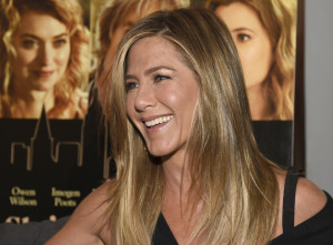 """Jennifer Aniston arrives at the Los Angeles premiere of """"She's Funny That Way"""" at the Harmony Gold theater on Wednesday, Aug. 19, 2015. (Photo by Chris Pizzello/Invision/AP)"""