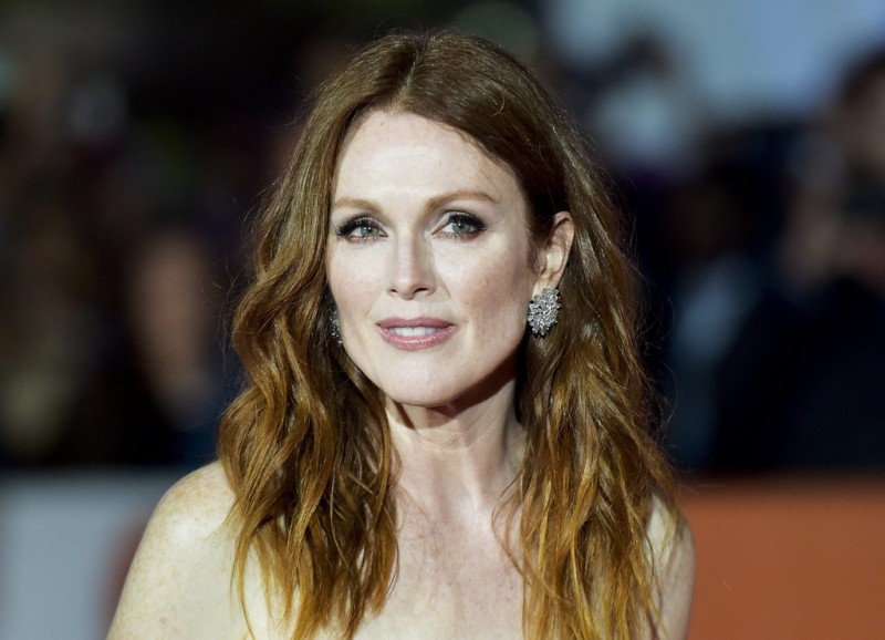 """Actress Julianne Moore poses for photographs on the red carpet for the film,""""Freeheld,"""" during the 2015 Toronto International Film Festival, in Toronto, on Sunday, Sept. 13, 2015. (Nathan Denette/The Canadian Press via AP)"""