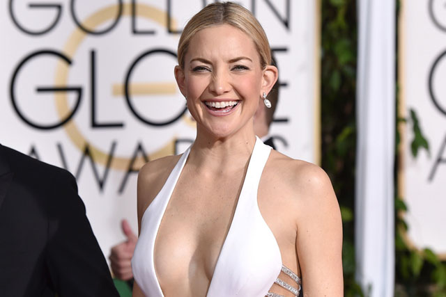 Kate Hudson poses in a Versace gown at the 72nd annual Golden Globe Awards at the Beverly Hilton Hotel on Sunday, Jan. 11, 2015, in Beverly Hills, Calif. (Photo by John Shearer/Invision/AP)
