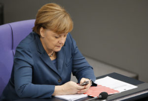 German Chancellor Merkel uses a Nokia slide mobile during a session of the lower house of parliament the Bundestag in Berlin