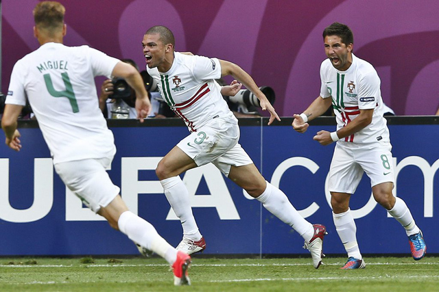 epa03263277 Portuguese players Pepe (C), Miguel Veloso (L) and Joao Moutinho celebrate Pepe's goal during a Group B match of the UEFA EURO 2012 at Arena Lviv Stadium, in Lviv, Ukraine, 13 June 2012.  EPA