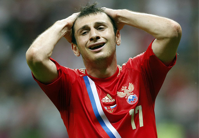 epa03268888 Alan Dzagoev of Russia reacts after missing a chance during the Group A preliminary round match of the UEFA EURO 2012 between Greece and Russia in Warsaw, Poland, 16 June 2012.  EPA