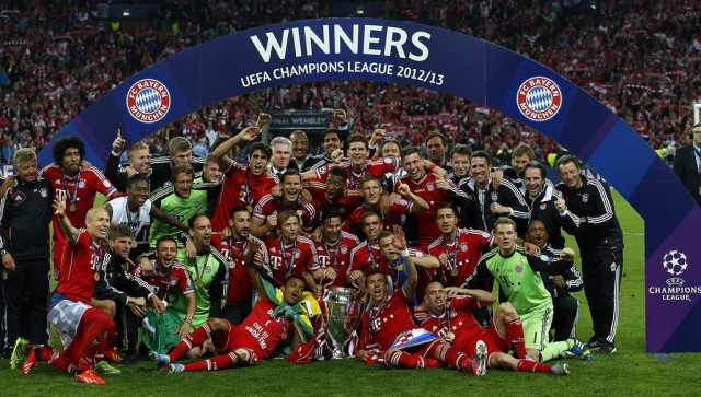 Bayern Munich FC team pose with their trophy and celebrate after the UEFA Champions League final between Borussia Dortmund and Bayern Munich at Wembley Stadium in London, Britain, 25 May 2013. EPA/KERIM OKTEN