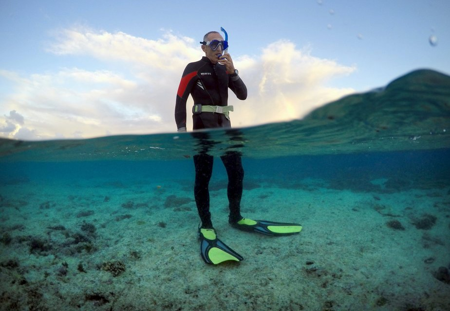"Peter Gash, owner and manager of the Lady Elliot Island Eco Resort, prepares to snorkel during an inspection of the reef's condition in an area called the 'Coral Gardens' located at Lady Elliot Island, north-east of the town of Bundaberg in Queensland, Australia, June 11, 2015. Gash snorkels every morning before he attends to managing duties on the island. UNESCO World Heritage delegates recently snorkelled on Australia's Great Barrier Reef, thousands of coral reefs, which stretch over 2,000 km off the northeast coast. Surrounded by manta rays, dolphins and reef sharks, their mission was to check the health of the world's largest living ecosystem, which brings in billions of dollars a year in tourism. Some coral has been badly damaged and animal species, including dugong and large green turtles, are threatened. UNESCO will say on Wednesday whether it will place the reef on a list of endangered World Heritage sites, a move the Australian government wants to avoid at all costs, having lobbied hard overseas. Earlier this year, UNESCO said the reef's outlook was ""poor"". REUTERS/David Gray PICTURE 14 OF 23 FOR WIDER IMAGE STORY ""GREAT BARRIER REEF AT RISK"" SEARCH ""GRAY REEF"" FOR ALL PICTURES"