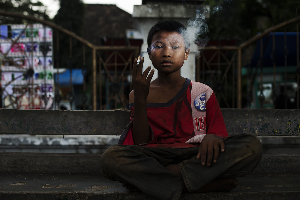 Cecep poses for a photo as he smokes on February 10, 2014. (Photo By: Michelle Siu)