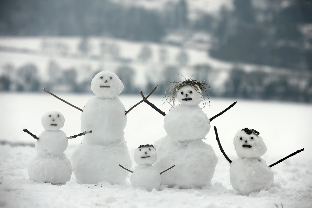 DORKING, UNITED KINGDOM - JANUARY 19: A family of snowmen sit on Box Hill on January 19, 2013 in Dorking, United Kingdom. Heavy snow around the UK caused hundreds of flight cancelations at Heathrow, with more travel disruptions expected during a snowy weekend. Approximately 3,000 schools were closed in England, Wales and Scotland. (Photo by Dan Kitwood/Getty Images)