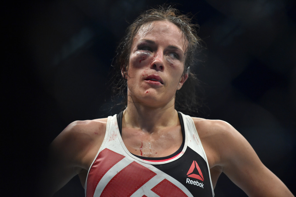 A beaten Valerie Letourneau of Canada gestures after Joanna Jedrzejczyk of Poland retained her UFC Strawweight title in Melbourne on November 15, 2015. RESTRICTED TO EDITORIAL USE NO ADVERTISING USE NO PROMOTIONAL USE NO MERCHANDISING USE. AFP PHOTO/Paul CROCK / AFP / PAUL CROCK