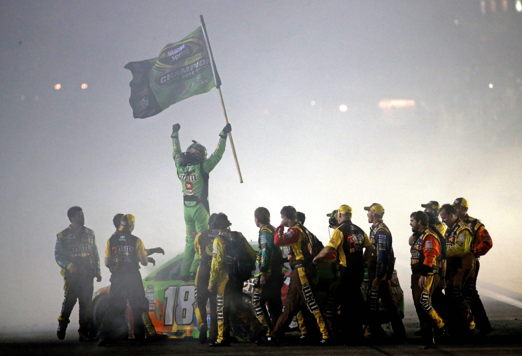 HOMESTEAD, FL - NOVEMBER 22: Kyle Busch, driver of the #18 M&M's Crispy Toyota, celebrates with his crew after winning the series championship and the NASCAR Sprint Cup Series Ford EcoBoost 400 at Homestead-Miami Speedway on November 22, 2015 in Homestead, Florida. (Photo by Mike Ehrmann/Getty Images) ***BESTPIX***