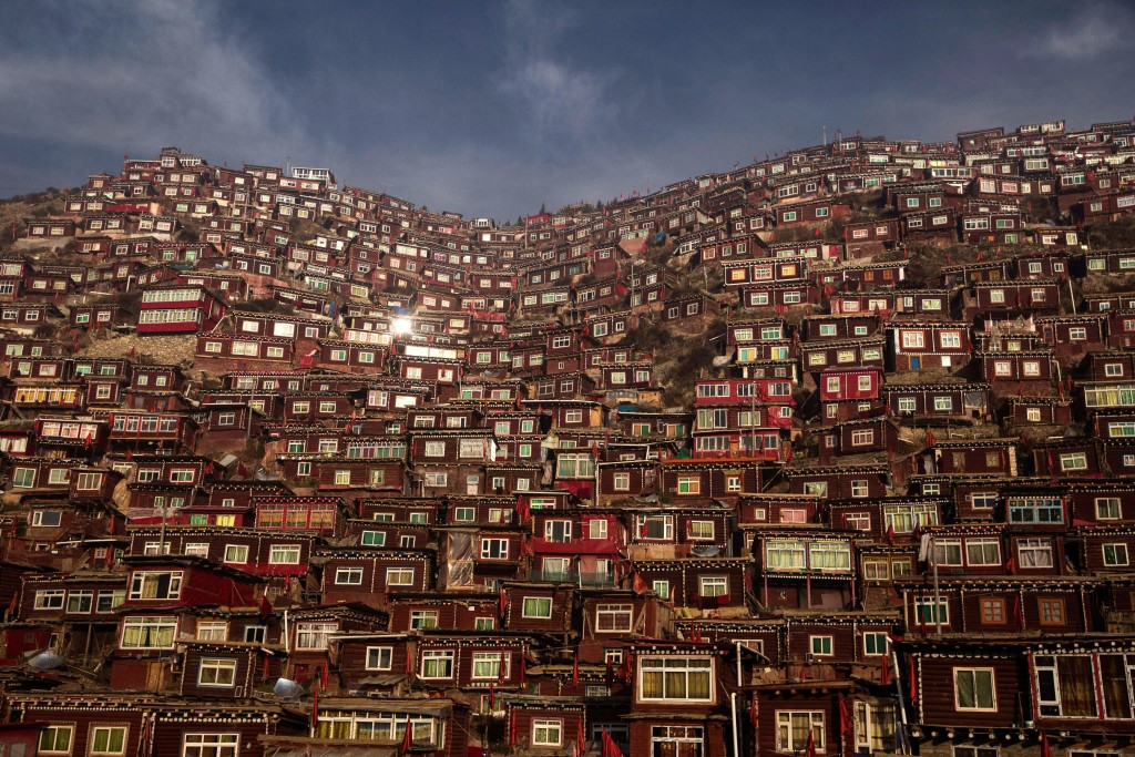 SERTAR, CHINA - OCTOBER 30: Dwellings where Tibetan Buddhist nuns and monks live are seen on a hillside at Larung Wuming Buddhist Institute on October 30, 2015 in Sertar county, in the remote Garze Tibetan Autonomous Prefecture, Sichuan province, China. Located high in the mountains of Sichuan, the Larung Wuming Buddhist Institute was founded in 1980 by an influential lama of the Nyingma sect and is widely regarded as the world's largest and most influential centre for Tibetan Buddhist studies. The school is home to thousands of monks and nuns and is popular for followers from all over the Tibetan areas and other parts of China. (Photo by Kevin Frayer/Getty Images)