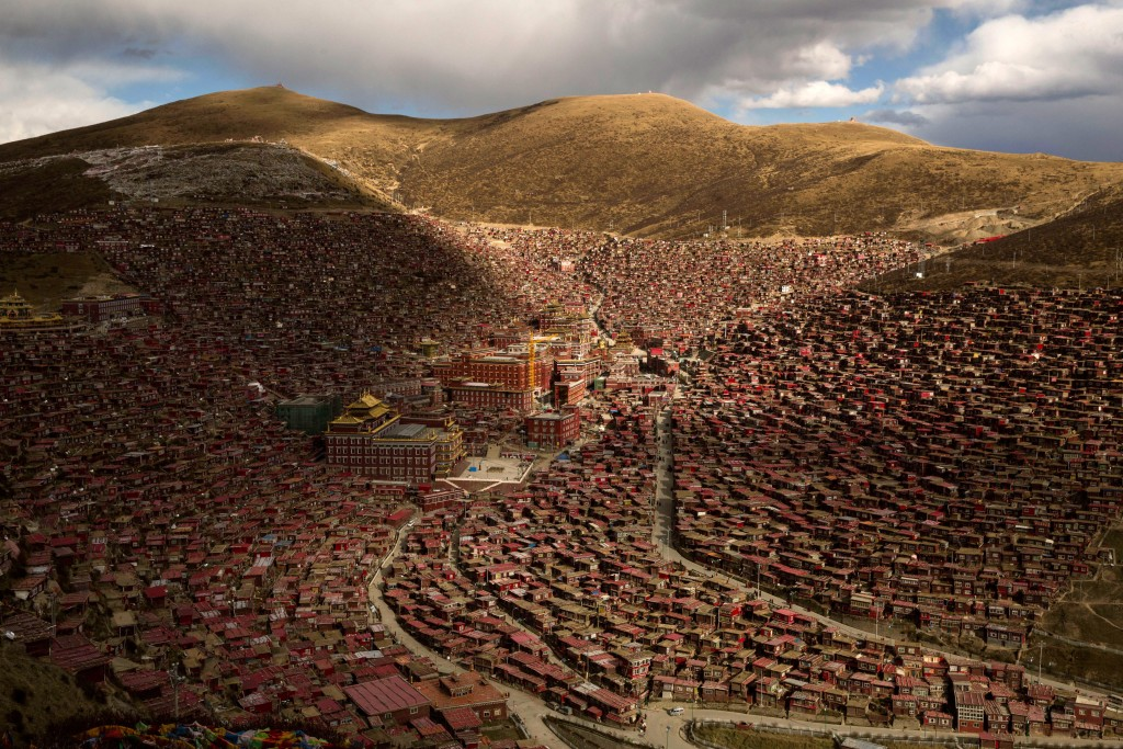 SERTAR, CHINA - OCTOBER 30: The Larung Wuming Buddhist Institute is seen on October 30, 2015 in the Larung Valley of Sertar county, in the remote Garze Tibetan Autonomous Prefecture, Sichuan province, China. Located high in the mountains of Sichuan, the Larung Wuming Buddhist Institute was founded in 1980 by an influential lama of the Nyingma sect and is widely regarded as the world's largest and most influential centre for Tibetan Buddhist studies. The school is home to thousands of monks and nuns and is popular for followers from all over the Tibetan areas and other parts of China. (Photo by Kevin Frayer/Getty Images)