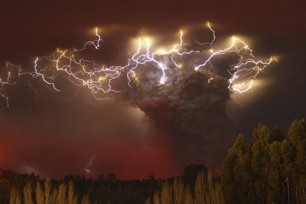 Lightning flashes around the ash plume at above the Puyehue-Cordon Caulle volcano chain near Entrelagos June 5, 2011. The volcano in the Puyehue-Cordon Caulle chain, dormant for decades, erupted in south-central Chile on Saturday, belching ash over 6 miles (10 km) into the sky, as winds fanned it toward neighboring Argentina, and prompted the government to evacuate several thousand residents, authorities said. Picture taken June 5. REUTERS/Carlos Gutierrez (CHILE - Tags: ENVIRONMENT DISASTER IMAGES OF THE DAY) FOR BEST QUALITY IMAGE: ALSO SEE GM1E77L02MK01. - RTR2NDD9