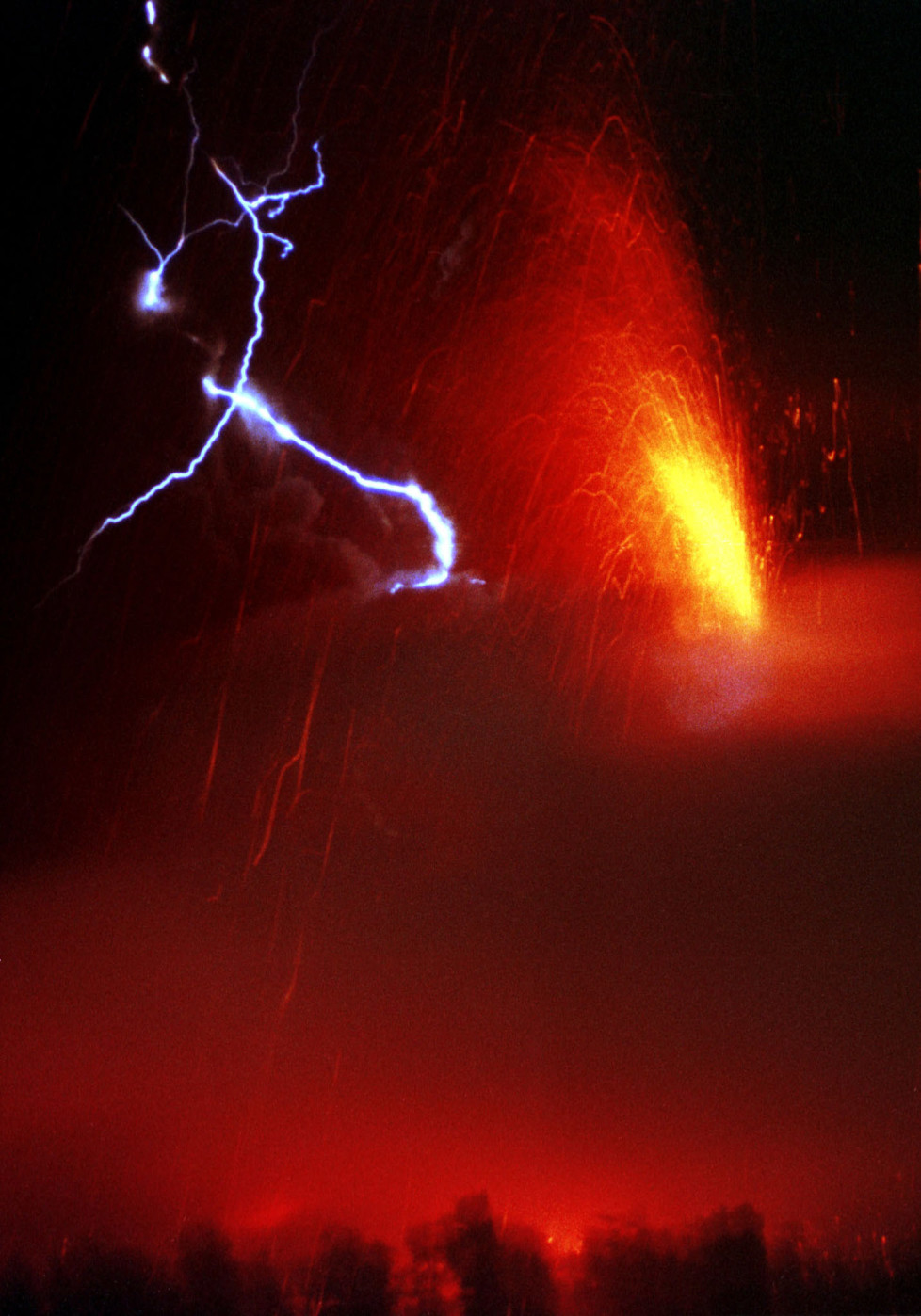 Lightning strikes over Pacaya Volcano, while it erupts lava and ash in Amatitlan, Guatemala, January 17, 2000. The Pacaya volcano, some 30 miles (48 km) south of the capital, spewed lava 3,000 feet (914 meters) into the air. RM/ME - RTRBTWU