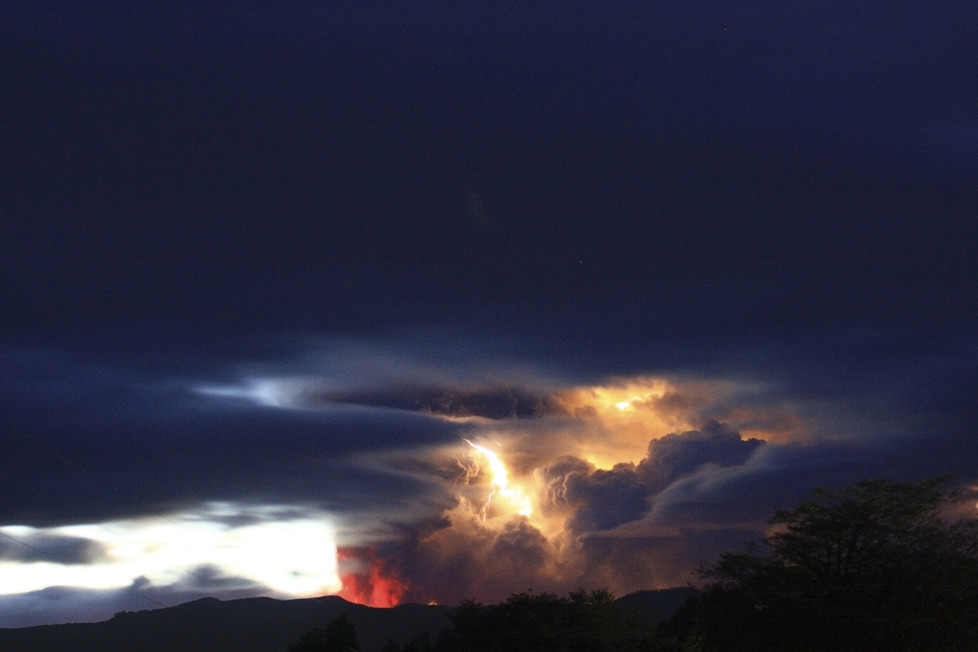 Lightning bolts strike around the Puyehue-Cordon Caulle volcanic chain in the Patagonia region at sunrise June 5, 2011. The volcano dormant for decades erupted in south-central Chile on Saturday, belching ash over 6 miles (10 km) into the sky, as winds fanned it toward neighboring Argentina, and prompting the government to evacuate several thousand residents, Chilean authorities said. REUTERS/Carlos Gutierrez (CHILE - Tags: DISASTER ENVIRONMENT IMAGES OF THE DAY) - RTR2NBMM