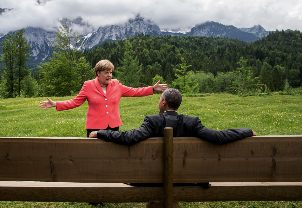 FOR USE AS DESIRED, YEAR END PHOTOS - FILE - German chancellor Angela Merkel speaks with U.S. president Barack Obama at Schloss Elmau hotel near Garmisch-Partenkirchen, southern Germany, Monday June 8, 2015 during the G-7 summit. (Michaek Kappeler/Pool Photo via AP, File)