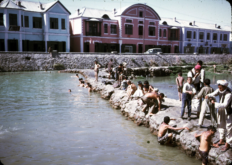 """""""Men and boys washing and swimming in the Kabul River."""""""