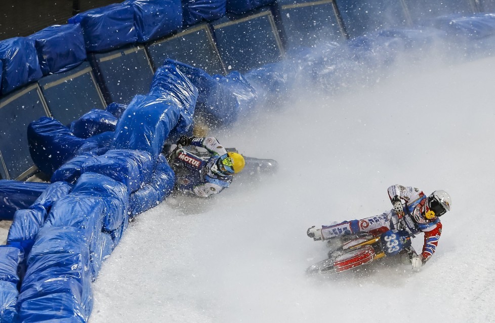 Egor Myshkovets of Russia crashes next to his teammate Daniil Ivanov during FIM Ice Speedway Gladiators World Championships at the Medeo rink in Almaty, Kazakhstan, February 20, 2016. REUTERS/Shamil Zhumatov TPX IMAGES OF THE DAY