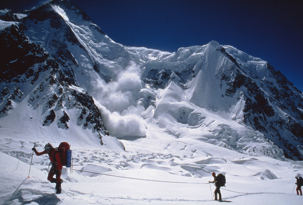 "NATIONAL GEOGRAPHIC SPECIAL -- ""Avalanche: The White Death"" Aired 05/08/1999 -- Pictured: Hikers with avalanche in background (Photo by Scott Spiker/NBC/NBCU Photo Bank via Getty Images)"