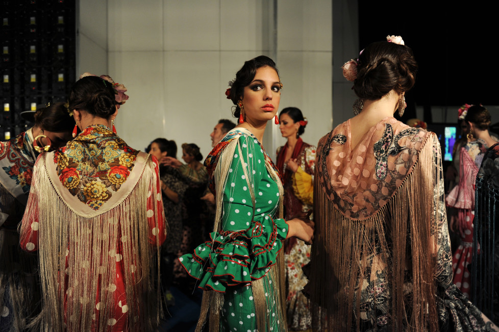 Models waits in the backstage of the SIMOF (International Flamenco Fashion Show) in Sevilla, on February 5, 2016. AFP PHOTO/ CRISTINA QUICLER / AFP / CRISTINA QUICLER