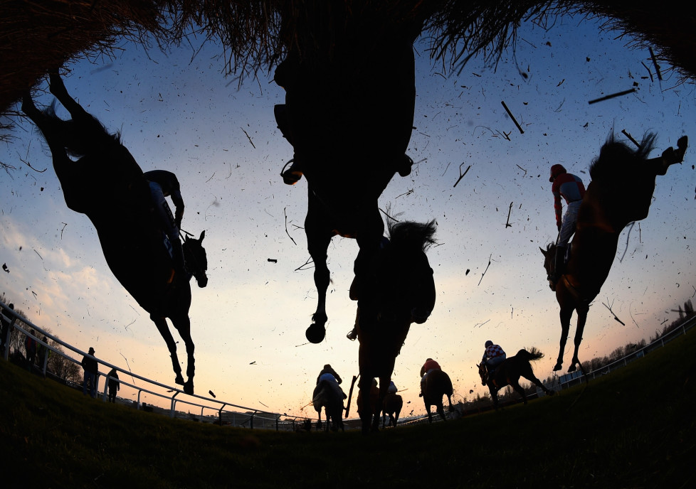 CHELTENHAM, ENGLAND - MARCH 17: Runners and riders clear a jump in the Fulke Walwyn Kim Muir Challenge Cup Handicap Chaseon day three, St Patrick's Thursday, of the Cheltenham Festival at Cheltenham Racecourse on March 17, 2016 in Cheltenham, England. (Photo by Mike Hewitt/Getty Images)