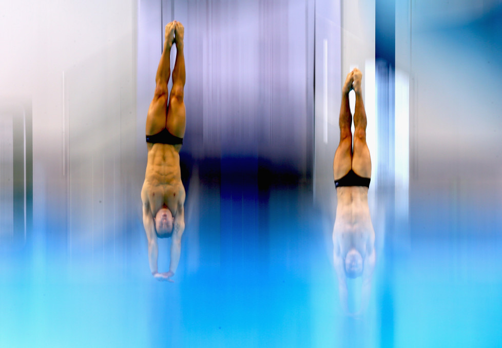 DUBAI, UNITED ARAB EMIRATES - MARCH 17: Tom Daley and Daniel Goodfellow of Great Britain dives in the Men's 10m Synchro Platform Final during day one of the FINA/NVC Diving World Series 2016 at the Hamdan Sports Complexon March 17, 2016 in Dubai, United Arab Emirates. (Photo by Francois Nel/Getty Images)
