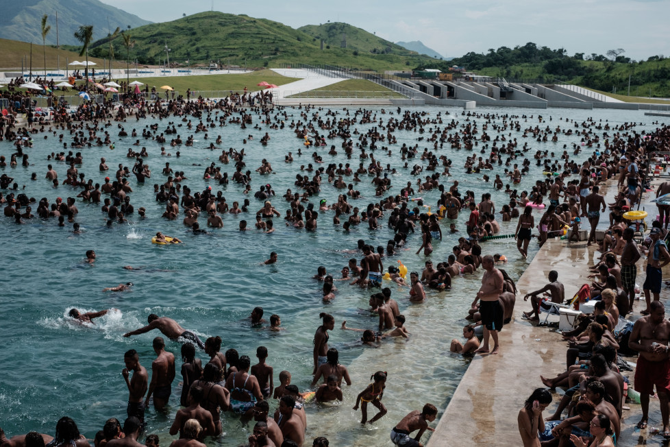 People enjoy the Whitewater Stadium built at Deodoro's X-Park for the Rio 2016 Olympic Games in Rio de Janeiro, Brazil, on February 28, 2016. The venue was opened to the public in late 2015 and will be closed Tuesday to deliver the stadium to the Olympic Committee. The Whitewater Stadium will host the canoe slalom events during the Olympic Games. AFP PHOTO / YASUYOSHI CHIBA / AFP / YASUYOSHI CHIBA