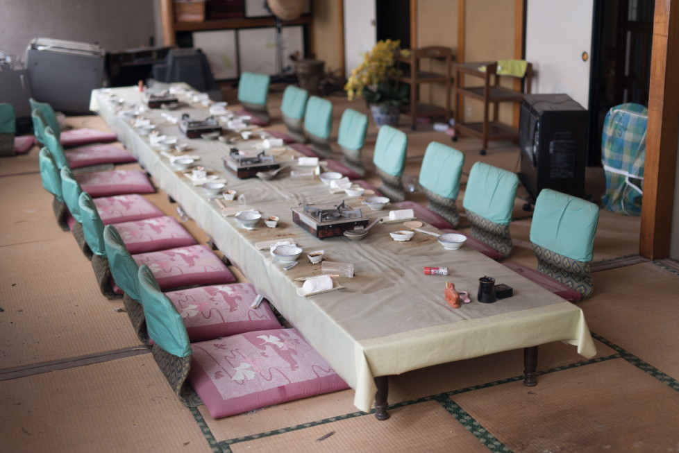 EXCLUSIVE IMAGES. PLEASE TRY FOR THE HIGHEST POSSIBLE FEES. MANDATORY CREDIT: Arkadiusz Podniesinski/REX Shutterstock Mandatory Credit: Photo by Arkadiusz Podniesinski/REX Shutterstock (5224634cs) A restaurant table with crockery left behind by guests Fukushima, Japan - Sep 2015 FULL COPY: http://www.rexfeatures.com/nanolink/r7ku MINIMUM USE FEE A photographer has taken stunning and revealing pictures of the exclusion zone from the 2011 Fukushima Nuclear Disaster. Within a 20km radius the radioactive exclusion zone demonstrates the dangerous nature of nuclear energy. A network of abandoned towns and villages that once housed hundreds of thousands of people, the exclusion zone of the largest nuclear accident since Chernobyl is eerie and frightening. (FOTO:DUKAS/REX)