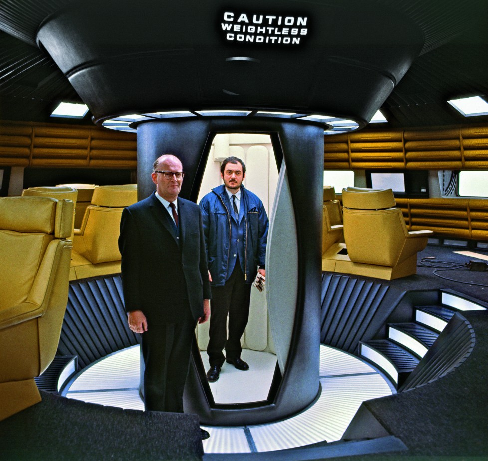 Stanley Kubrick and Arthur C. Clarke pose for publicity photographs inside the passenger deck set of the Aries lunar ferry. © Stanley Kubrick Archives/TASCHEN © 2014 Turner Entertainment Co. 2OO1: A Space Odyssey and all related characters and elements are trademarks of and © Turner Entertainment Co. (s14)