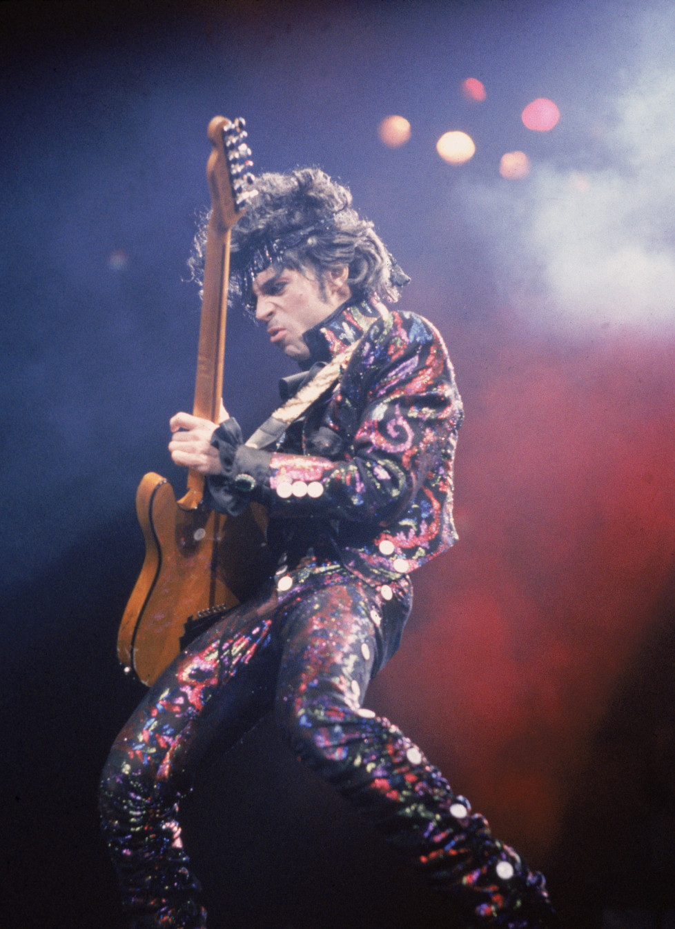 American rock singer and songwriter Prince plays guitar on stage during a concert, 1985. (Photo by Frank Micelotta/Getty Images)