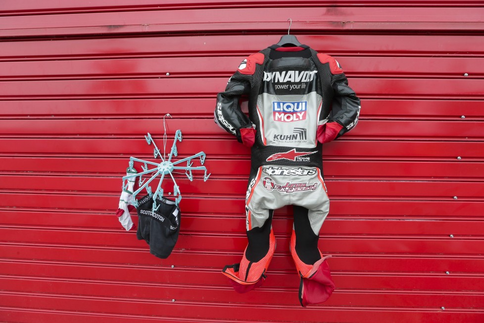 The suit of Moto2 rider Jonas Folger of Germany hangs next to socks and underwear at the Termas de Rio Hondo circuit in Argentina, Sunday, April 3, 2016. Folger finished third in the race. (AP Photo/Victor R. Caivano)