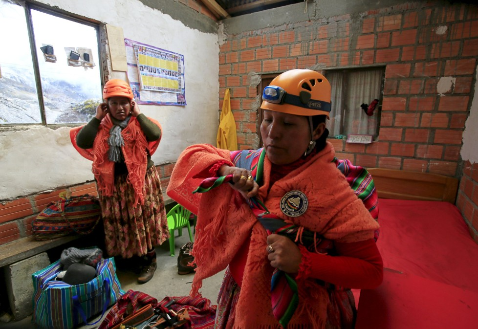 "Aymara indigenous women prepare at the Huayna Potosi mountain refuge, Bolivia April 6, 2016. Two years ago, about a dozen Aymara indigenous women, aged 42 to 50, who worked as porters and cooks for mountaineers at base camps and mountain climbing refuges on the steep, glacial slopes of Huayna Potosi, an Andean peak outside La Paz, Bolivia, put on crampons under their wide traditional skirts and started to do their own climbing. REUTERS/David Mercado SEARCH ""CHOLITA CLIMBERS"" FOR THIS STORY. SEARCH ""THE WIDER IMAGE"" FOR ALL STORIES"