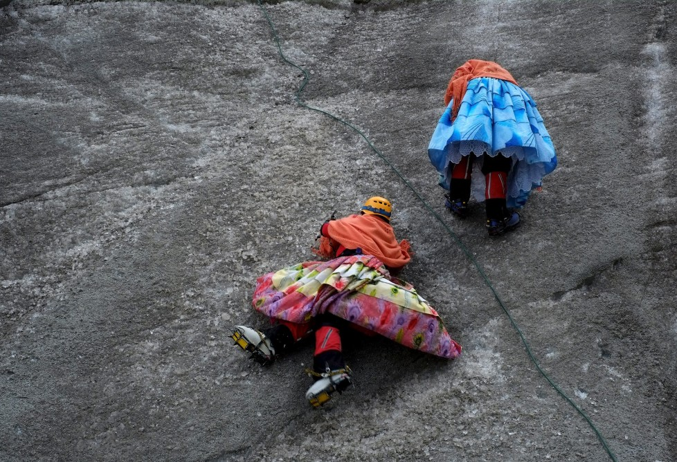 "Aymara indigenous women practise on a glacier of the Huayna Potosi mountain on the outskirts of La Paz, Bolivia, April 6, 2016. Two years ago, about a dozen Aymara indigenous women, aged 42 to 50, who worked as porters and cooks for mountaineers at base camps and mountain climbing refuges on the steep, glacial slopes of Huayna Potosi, an Andean peak outside La Paz, Bolivia, put on crampons under their wide traditional skirts and started to do their own climbing. REUTERS/David Mercado SEARCH ""CHOLITA CLIMBERS"" FOR THIS STORY. SEARCH ""THE WIDER IMAGE"" FOR ALL STORIES"