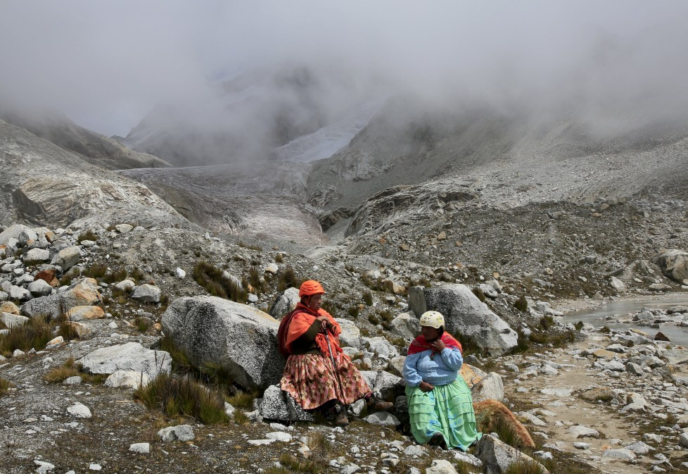 "Aymara indigenous women rest at the Huayna Potosi mountain, Bolivia April 6, 2016. Two years ago, about a dozen Aymara indigenous women, aged 42 to 50, who worked as porters and cooks for mountaineers at base camps and mountain climbing refuges on the steep, glacial slopes of Huayna Potosi, an Andean peak outside La Paz, Bolivia, put on crampons under their wide traditional skirts and started to do their own climbing. REUTERS/David Mercado SEARCH ""CHOLITA CLIMBERS"" FOR THIS STORY. SEARCH ""THE WIDER IMAGE"" FOR ALL STORIES"