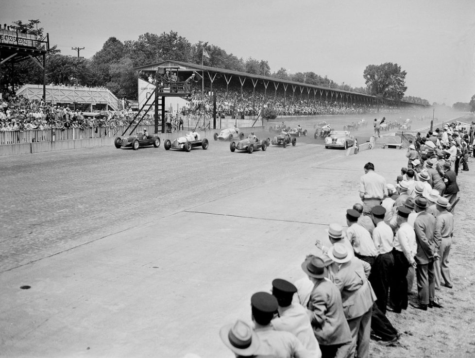 The entries in the Indianapolis 500-mile race at the Indianapolis Motor Speedway track pass the Chrysler-Newport, Phaeton, pace car and driver A.B. Couture, far right, as they start the first lap of the 200 circuits they have to make in Indianapolis, Indiana, May, 30, 1941. In the front line are, from left to right, Wilbur Shaw (2), Rex Mays (1), and Mauri Rose (3), who won the race. (AP Photo)