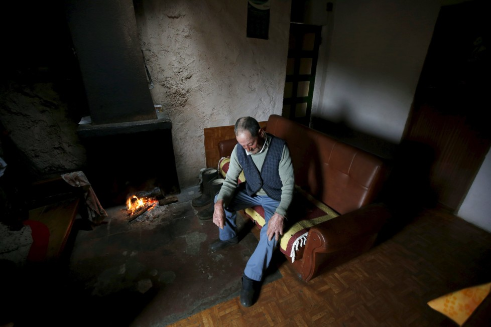 "Fernando rests on a sofa inside his house in Povoa de Agracoes, near Chaves, Portugal April 19, 2016. In the villages of Agracoes and Povoa de Agracoe the steady drip-drip of emigration has brought down population numbers from more than 50 residents to fewer than a dozen each. These remaining villagers share the same glum acceptance that, after they have gone, their villages will die out too. It is the same desolate picture in scores of other backwater settlements in Portugal's interior, north to south. REUTERS/Rafael Marchante SEARCH ""ABANDONED PORTUGAL"" FOR THIS STORY. SEARCH ""THE WIDER IMAGE"" FOR ALL STORIES"
