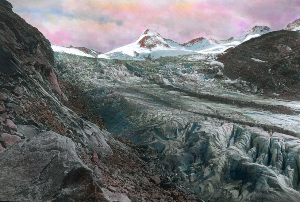 """AUSTRIA - CIRCA 1910: Great Geiger. Its beset with glaciers and earlier it was called """"Obersulzenbacher Venediger"""" or """"Heiliggeistkogel"""". The mountain is 3360 m high and is part of the borderline between Tyrol and Salzburg. Handcolored lantnern slide around 1910. (Photo by Imagno/Getty Images)"""