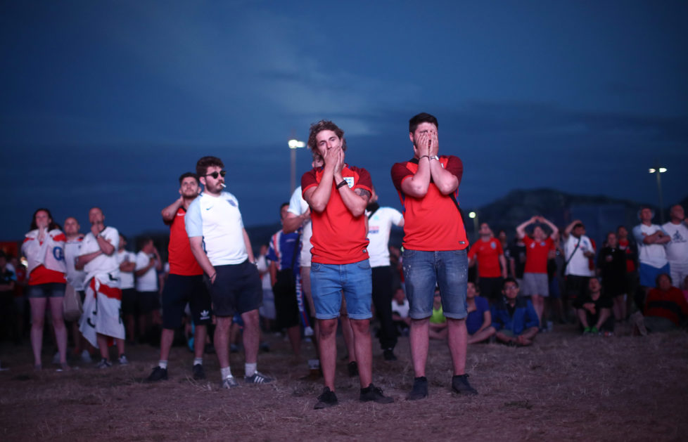 MARSEILLE, FRANCE - JUNE 11: England fans react to the game against Russia at a fanzone on June 11, 2016 in Marseille, France. Football fans from around Europe have descended on France for the UEFA Euro 2016 football tournament. (Photo by Carl Court/Getty Images)