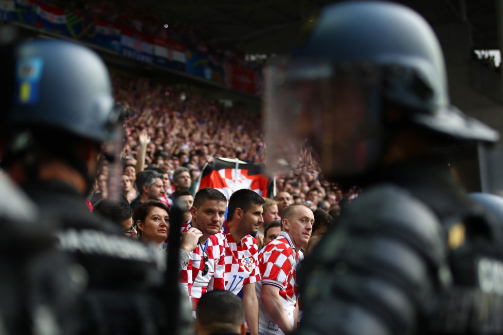SAINT-ETIENNE, FRANCE - JUNE 17: Riot Police stand infront of the Croatia supporters during the UEFA EURO 2016 Group D match between Czech Republic and Croatia at Stade Geoffroy-Guichard on June 17, 2016 in Saint-Etienne, France. (Photo by Clive Brunskill/Getty Images)