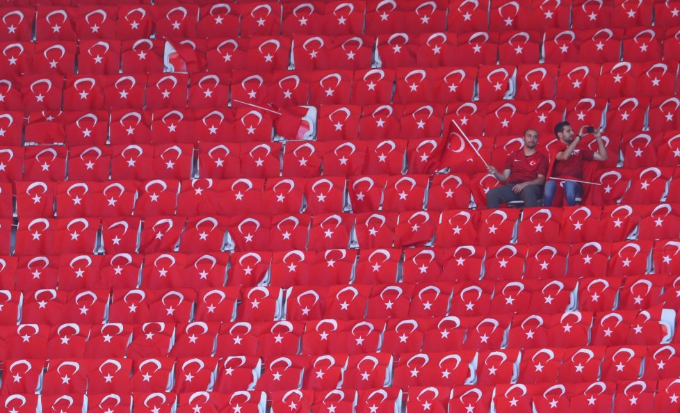 NICE, FRANCE - JUNE 17: Turkey fans sit with Turkish national flags prior to the UEFA EURO 2016 Group D match between Spain and Turkey at Allianz Riviera Stadium on June 17, 2016 in Nice, France. (Photo by Lars Baron/Getty Images)