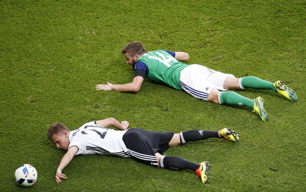 epaselect epa05381813 Stuart Dallas (R) of Northern Ireland and Joshua Kimmich (L) of Germany lie on the pitch during the UEFA EURO 2016 group C preliminary round match between Northern Ireland and Germany at Parc des Princes in Paris, France, 21 June 2016. (RESTRICTIONS APPLY: For editorial news reporting purposes only. Not used for commercial or marketing purposes without prior written approval of UEFA. Images must appear as still images and must not emulate match action video footage. Photographs published in online publications (whether via the Internet or otherwise) shall have an interval of at least 20 seconds between the posting.) EPA/YOAN VALAT EDITORIAL USE ONLY