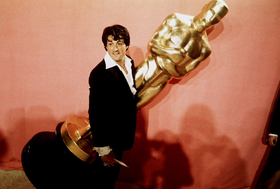 Actor Sylvester Stallone at Academy Awards presentation, holding giant Oscar. His film, Rocky, received Best Picture award. (Photo by Julian Wasser/The LIFE Images Collection/Getty Images)