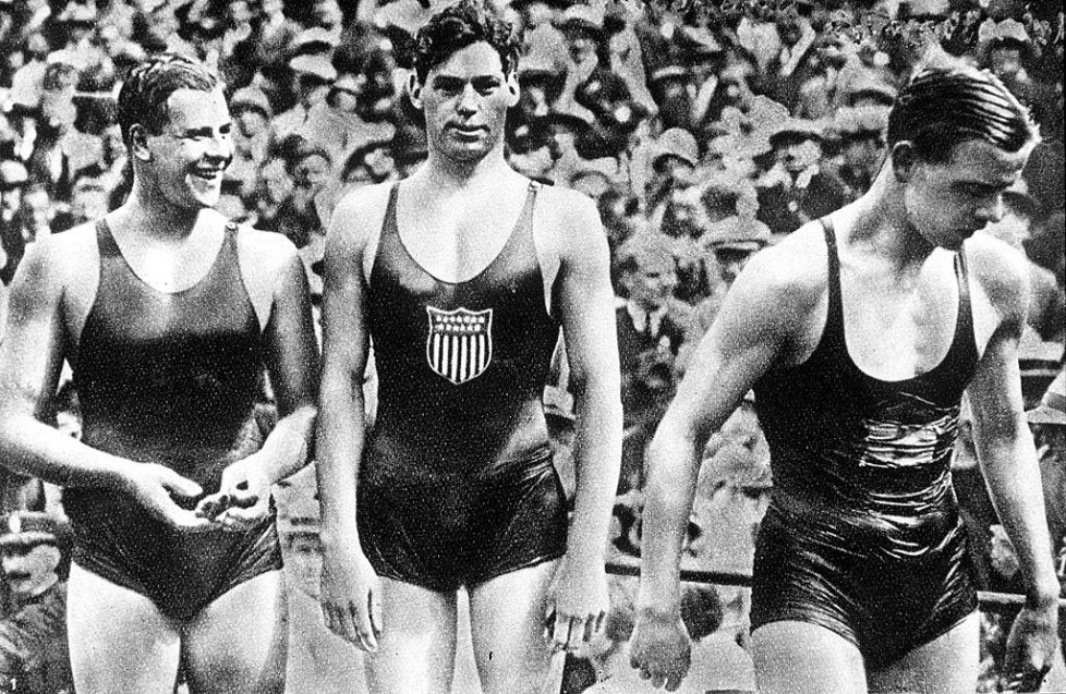 """1924 Olympic Games, Paris, France, Men's 400 Metres Freestyle Swimming, USA's Johnny Weissmuller (C) who won the gold medal in the race with Australia's Andrew """"Boy"""" Charlton (R) who took bronze and Swden's A, Borg (L) who took silver (Photo by Popperfoto/Getty Images)"""