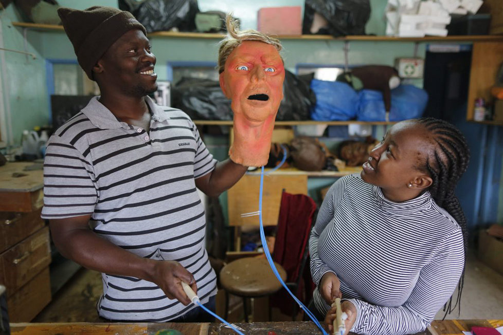 epa05548731 (13/19) A puppet maker holds up the Donald Trump puppet as he controls its eye movement at a puppet workshop near the studio where the shooting of the 11th season of 'The XYZ Show' satirical puppet show takes place in Nairobi, Kenya, 23 August 2016. The XYZ Show is Kenya's popular satirical television program and has been taking pokes at the country's political elites and international figures ever since it aired its first episode in 2009. With the 2016 US presidential elections, the show is now taking on Republican Presidential candidate Donald Trump. EPA/DAI KUROKAWA PLEASE REFER TO ADVISORY NOTICE (epa05548718) FOR FULL FEATURE TEXT